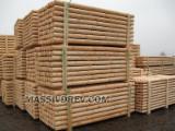 machine-rounded pine poles d.8, 10 cm.