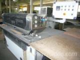 We offer veneer splicing machine.