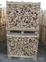 Firewood cleaved. Wood boxes 1m3 - 2m3 or Packed in bags. All Europe