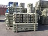Softwood  Logs For Sale Poland - Machine-rounded poles for sale from Belarus
