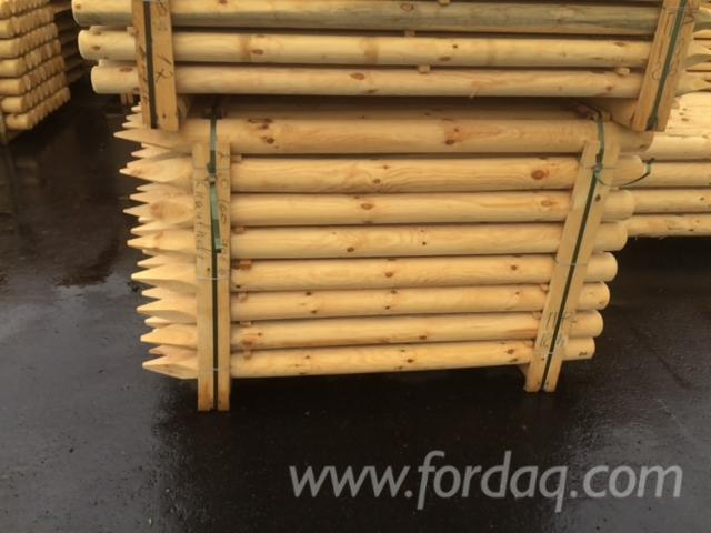 Exporting-machine-rounded-poles-and-half-poles-from-pine