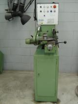 Grinding machine for HSS blades for iron