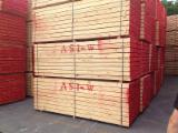 Softwood  Sawn Timber - Lumber - PEFC 0.095 mm Air Dry (AD) Radiata Pine Planks (boards)  from Spain