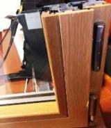 Ferestre - Usi si geamuri lemn stratificat - 180 euro/m2