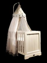 We manufacture baby cribs for nurseries