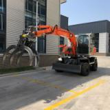 Mobile Excavator - Mobile excavator with grapple wood timber logs