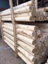 North America Softwood Logs - Northern White Cedar 2,5-3,5 in Debarked or Machine rounded with Knotty grade Poles from Canada