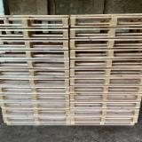 Wooden pallets with pressed blocks