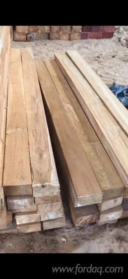 Teak-Round-Logs